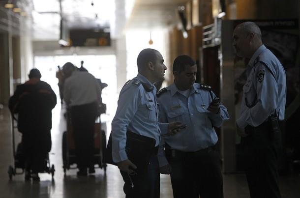 "Israeli police officers converse at Ben Gurion International Airport near Tel Aviv April 15, 2012. Hundreds of police officers were deployed in and around Tel Aviv's Ben Gurion Airport, Israel's main gateway to the world, as a pro-Palestinian ""fly-in"" to Tel Aviv got off to a slow start on Sunday after Israel scrambled to block activists from boarding flights in Europe. REUTERS/Ronen Zvulun"