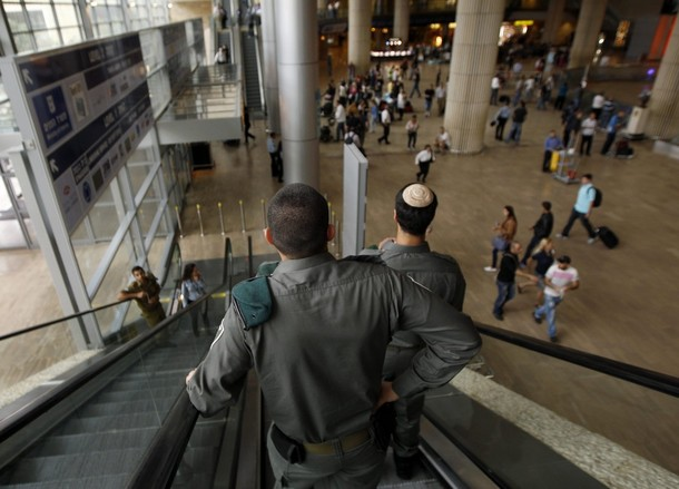 "Israeli border police ride an escalator at Ben Gurion International Airport near Tel Aviv April 15, 2012. Hundreds of police officers were deployed in and around Tel Aviv's Ben Gurion Airport, Israel's main gateway to the world, as a pro-Palestinian ""fly-in"" to Tel Aviv got off to a slow start on Sunday after Israel scrambled to block activists from boarding flights in Europe. REUTERS/Ronen Zvulun"
