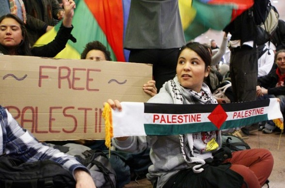 "Demonstrators sit as around 100 pro-Palestinian activists stage a protest at Brussels national airport in Zaventem early April 15, 2012. Some 1,200 Palestinian supporters throughout Europe have bought plane tickets for an April 15 visit to the West Bank as part of a campaign called ""Welcome to Palestine"". Organisers said the aim was to help open an international school and a museum, but Israel has denounced the activists as provocateurs and said it would deny entry to anyone who threatened public order. REUTERS/Sebastien Pirlet"