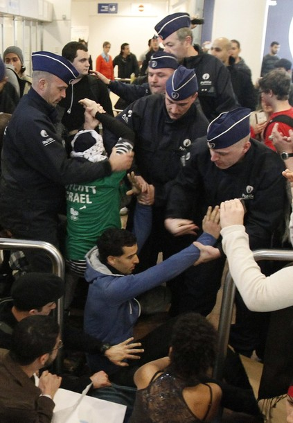 "Police officers intervene as around 100 pro-Palestinian activists stage a protest at Brussels national airport in Zaventem early April 15, 2012. Some 1,200 Palestinian supporters throughout Europe have bought plane tickets for an April 15 visit to the West Bank as part of a campaign called ""Welcome to Palestine"". Organisers said the aim was to help open an international school and a museum, but Israel has denounced the activists as provocateurs and said it would deny entry to anyone who threatened public order. REUTERS/Sebastien Pirlet"
