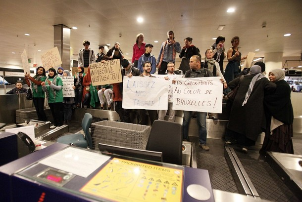 "Demonstrators occupy a luggage area as around 100 pro-Palestinian activists stage a protest at Brussels national airport in Zaventem early April 15, 2012. Some 1,200 Palestinian supporters throughout Europe have bought plane tickets for an April 15 visit to the West Bank as part of a campaign called ""Welcome to Palestine"". Organisers said the aim was to help open an international school and a museum, but Israel has denounced the activists as provocateurs and said it would deny entry to anyone who threatened public order. REUTERS/Sebastien Pirlet"