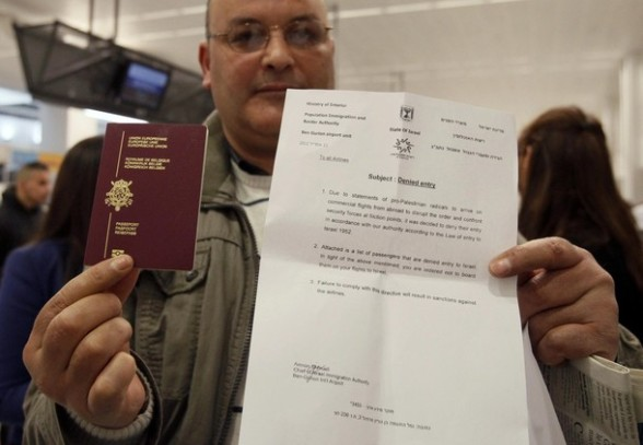 "A would-be passenger poses with his passport and a letter denying him access to Israel as around 100 pro-Palestinian activists stage a protest at Brussels national airport in Zaventem early April 15, 2012. Some 1,200 Palestinian supporters throughout Europe have bought plane tickets for an April 15 visit to the West Bank as part of a campaign called ""Welcome to Palestine"". Organisers said the aim was to help open an international school and a museum, but Israel has denounced the activists as provocateurs and said it would deny entry to anyone who threatened public order. REUTERS/Sebastien Pirlet"
