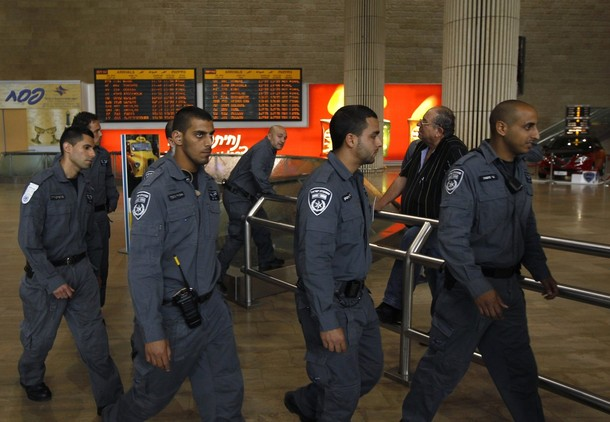 "Israeli police walk in the arrival hall at Ben Gurion International Airport near Tel Aviv April 15, 2012. Hundreds of police officers were deployed in and around Tel Aviv's Ben Gurion Airport, Israel's main gateway to the world, as a pro-Palestinian ""fly-in"" to Tel Aviv got off to a slow start on Sunday after Israel scrambled to block activists from boarding flights in Europe. REUTERS/Ronen Zvulun"