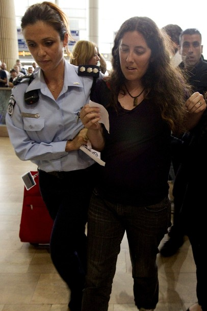 "An Israeli policewoman arrests an Israeli left-wing activist at Ben Gurion air port near Tel Aviv on April 15, 2012 as hundreds of Israeli police, many undercover, are at the airport to block the arrival of pro-Palestinian activists taking part in a ""Welcome to Palestine"" fly-in. Israel vowed to prevent entry  of activists, warning foreign airlines they would be forced to foot the bill for the activists' immediate return home in a move which saw many carriers toeing the line, prompting a furious response from passengers. AFP PHOTO/JACK GUEZ"