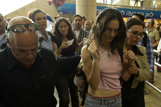 "Israeli undercover police officers arrest left-wing activists at Ben Gurion air port near Tel Aviv on April 15, 2012 as hundreds of Israeli police, many undercover, are at the airport to block the arrival of pro-Palestinian activists taking part in a ""Welcome to Palestine"" fly-in. Israel vowed to prevent entry  of activists, warning foreign airlines they would be forced to foot the bill for the activists' immediate return home in a move which saw many carriers toeing the line, prompting a furious response from passengers. AFP PHOTO/JACK GUEZ"
