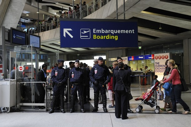 "French police stand guard next to a gate at Charles-de-Gaulle airport in Roissy near Paris July 8, 2011. A Hungarian airline stopped dozens of French activists heading for a pro-Palestinian ""fly-in"" in Israel from boarding a plane in Paris on Thursday. Some 600 people from around Europe, of which roughly 350 are from France, are trying to visit the city of Bethlehem at the invitation of a Palestinian group in an operation dubbed ""Welcome to Palestine"".       REUTERS/Gonzalo Fuentes"