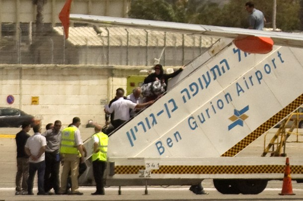 "Pro-Palestinian activists are escorted onto a plane heading back to Belgium at Israel's  Ben Gurion international airport near Tel Aviv on April 15, 2012. Israel barred 40 pro-Palestinian activists who had flown in for a ""Welcome to Palestine"" campaign, detaining 40 passengers on suspicion of being part of the fly-in move, better known as the ""flytilla,"" with all now likely to be deported as hundreds more would-be protesters were stranded at airports across Europe.   AFP PHOTO/JACK GUEZ"