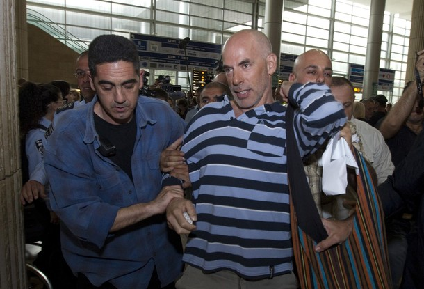 "Undercover Israeli police arrest an Israeli left-wing activist at Ben Gurion airport near Tel Aviv on April 15, 2012 as hundreds of Israeli police, many undercover, are stationed at the airport to block the arrival of pro-Palestinian activists taking part in a ""Welcome to Palestine"" fly-in. Israel vowed to prevent entry  of activists, warning foreign airlines they would be forced to foot the bill for the activists' immediate return home in a move which saw many carriers toeing the line, prompting a furious response from passengers. AFP PHOTO/JACK GUEZ"